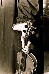Model holding a violin