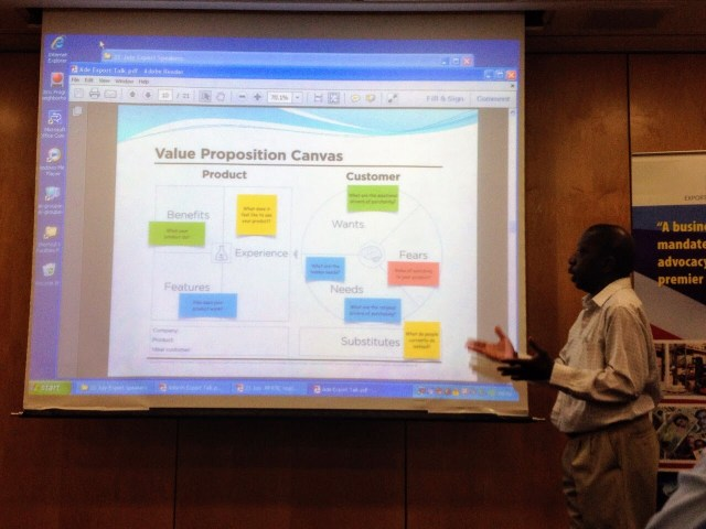 ade awokoya presents on business value proposition at coaching for purpose seminar