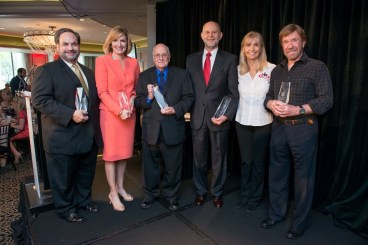 2015 Houston's Heroes Award Recipients from left to right Lee Vela, Harris County District Attorney Devon Anderson, Eddee Hestand, George Blamire with CenterPoint Energy and Gena and Chuck Norris