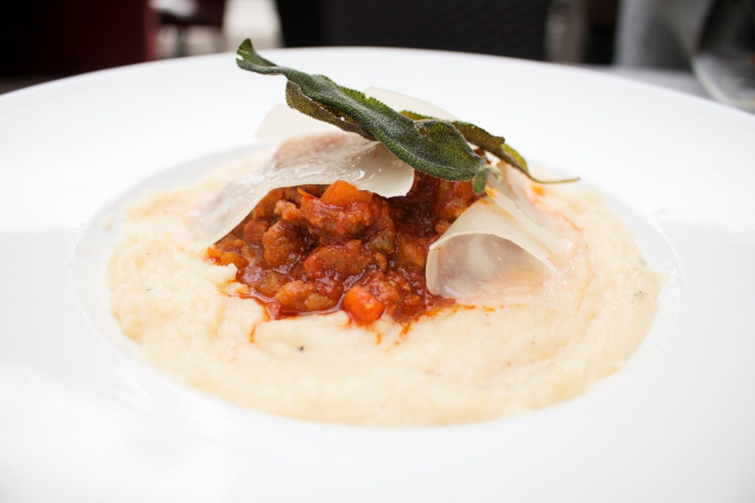 Soft Parmesan polenta with sausage ragu