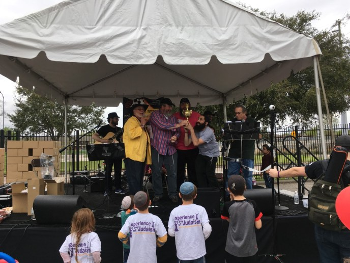 Friendship CircleChabad OutreachChai Learning Center of West Houston team accepting their 2nd place award