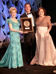 HOUSTON, TX - MAY 24: Honoree Rosanette Cullen (R) accepts the Margaret Alkek Williams Humanitarian Award from Gala Committee Presenter Margaret Alkek Williams and CDO & EVP of UNICEF USA Barron Segar at the fourth annual UNICEF Audrey Hepburn® Society Ball on May 24, 2017 in Houston, Texas. (Photo by Bob Levey/Getty Images for UNICEF)