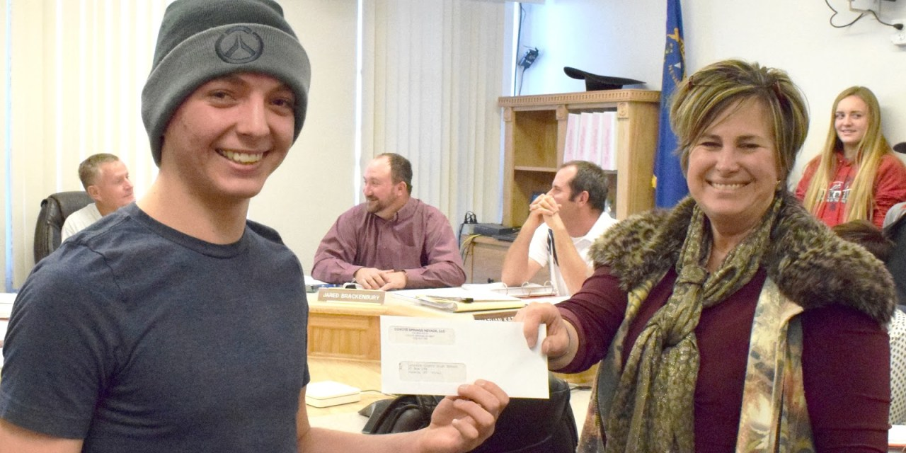 Coyote Springs Makes Donation for LCHS Trip