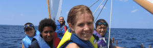 Image of five summer camp kids sailing