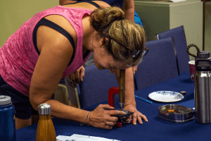 Image of woman looking into a microscope during the Leaning from the Lake Professional Development course.