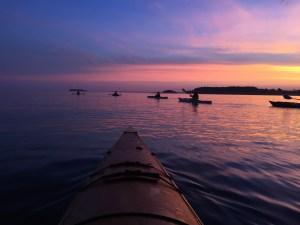 Kayaks on the lake at sunrise