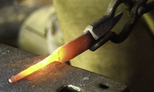 A blade being forged