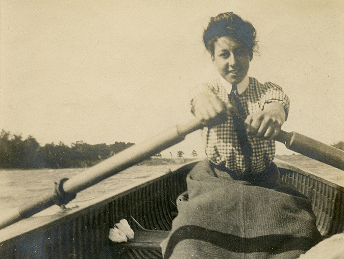 Woman rowing a rowboat