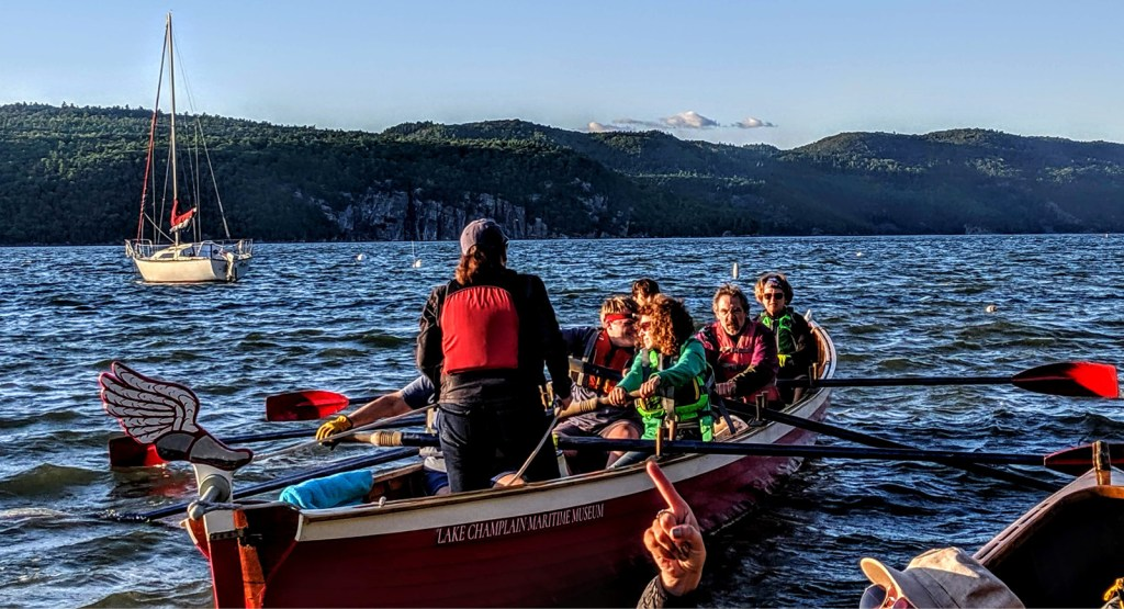 A group of adults get ready to row