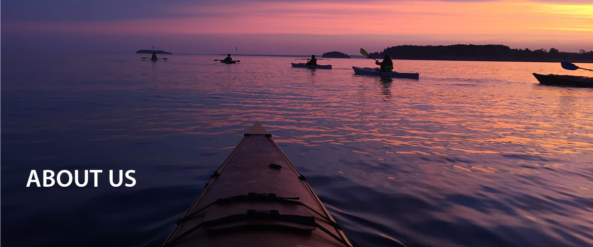 Kayaks on Lake Champlain at sunrise