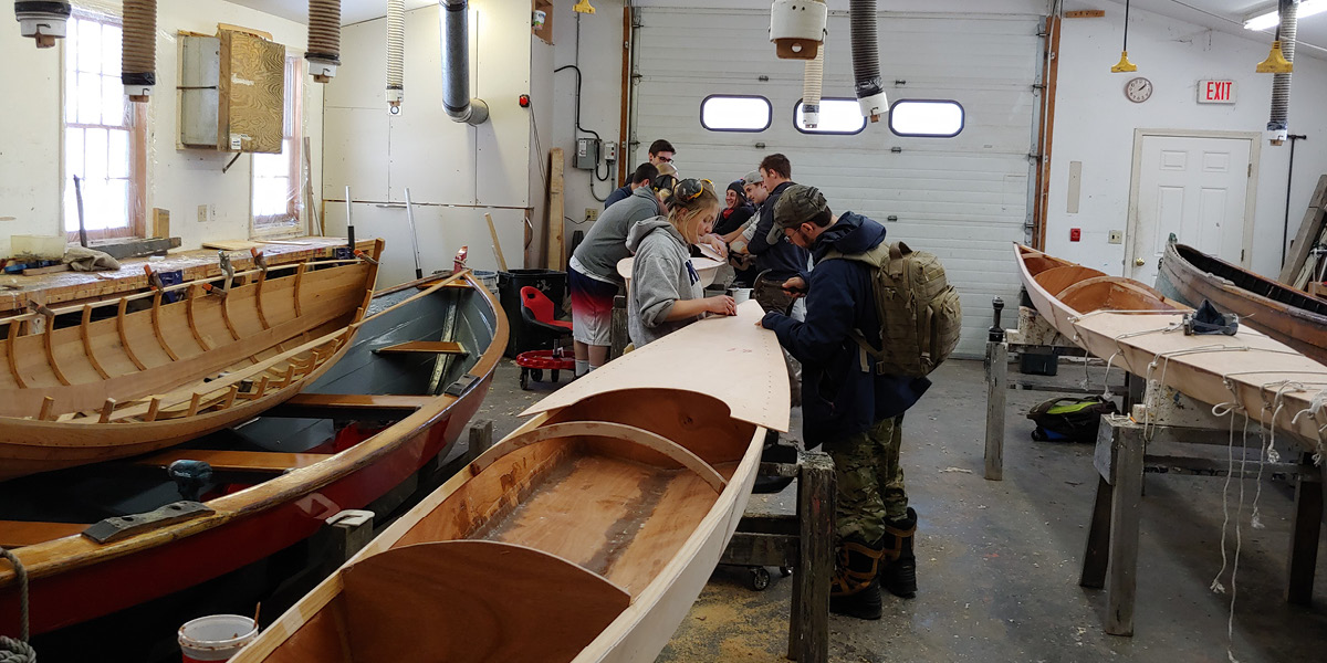 Students learn how to build a kayak in the boat shop