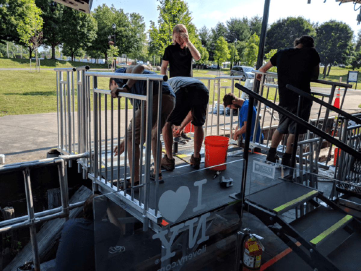The Crew of Lois McClure helping setup the gangway for the GlassBarge.
