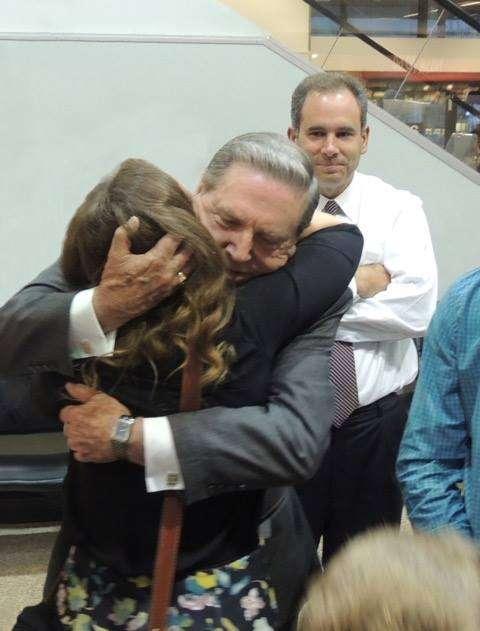 Elder Holland with granddaughter.