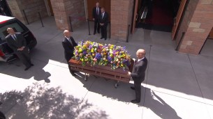President Packer's casket is adorned with flowers before being brought into the Tabernacle.