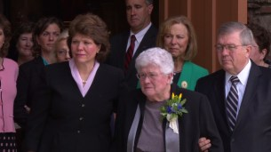 Donna Packer, wife of President Packer, exits the Tabernacle alongside family members.