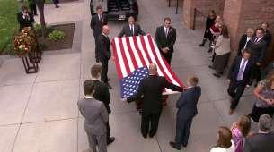 A flag is draped over Elder Scott's casket.