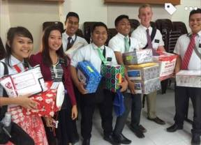 Happy missionaries with their Christmas gifts.