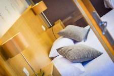 Tête de lit de la chambre junior prestige à l'hôtel le Chalet à Ax les Thermes