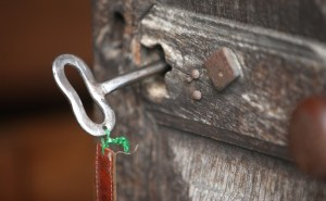 Old key on the door of a church.