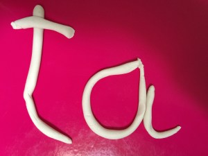 Ta spelled out in play doh
