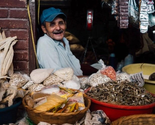 man at market stand