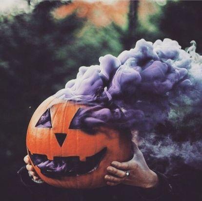 Image of pumpkin with purple smoke