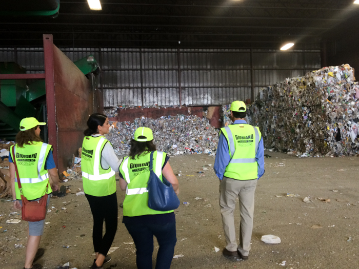 Workers touring recycling facility