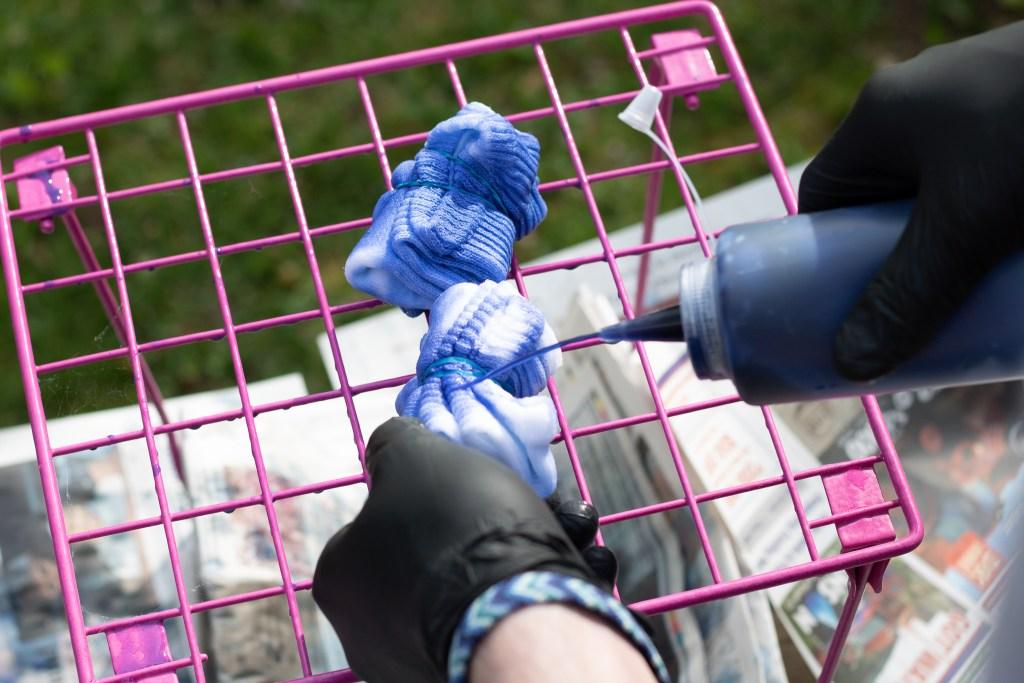 blue RIT fabric dye being put on crew socks