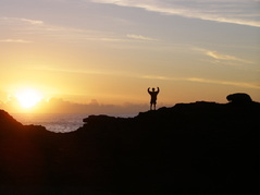 Photo: Person Standing On Top of a Mountain Arms Raised