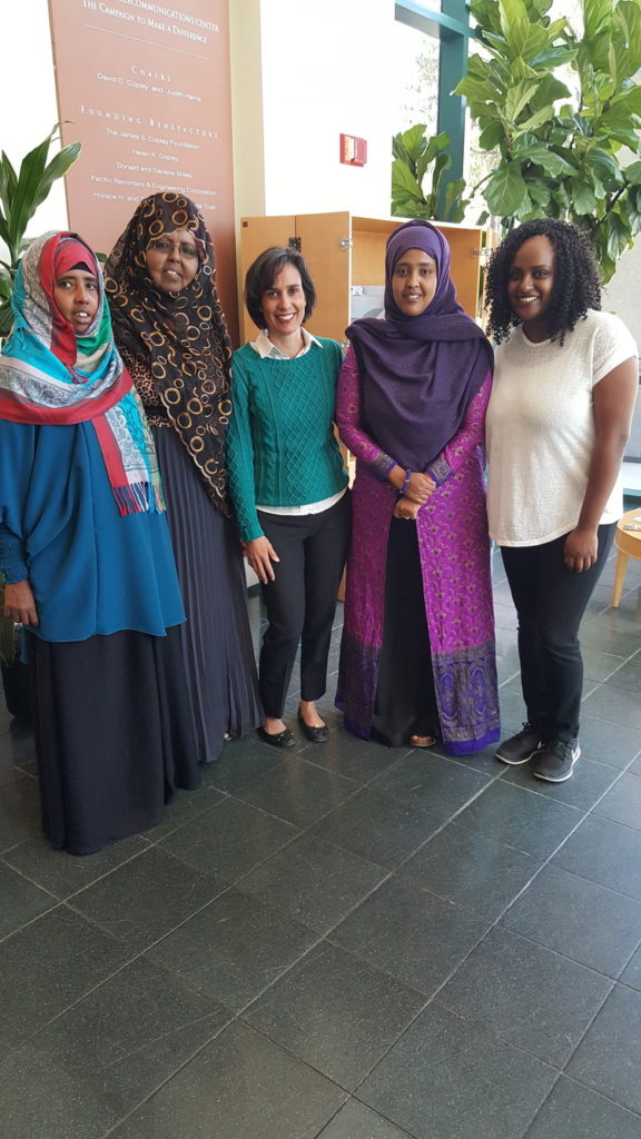 The interviewees, plus Sahra (UWEAST) and Amina (UCSD Peds Center for Community Health) bask in their fame in the KPBS lobby.