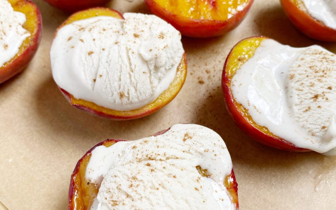 A quintessential summer dessert: grilled peaches with vanilla bean ice cream