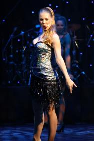 Leandra Ramm picture, singing and wearing sparkling dress