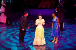 Leandra Ramm picture, singing and wearing yellow gown Take One