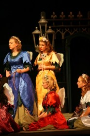 Leandra Ramm picture, wearing a gold gown in a play
