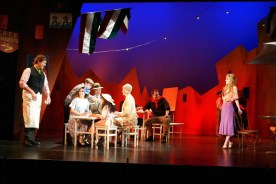Leandra Ramm picture, wearing a purple dress in a drama play Take Two