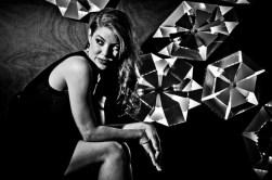 Leandra Ramm black & white picture, wearing black dress sitting down Take Three