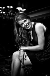Leandra Ramm black & white picture, wearing black dress sitting down Take One