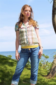 Leandra Ramm picture, wearing square texture colorful shirt with tree background Take Two