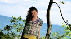 Leandra Ramm picture, wearing square texture colorful shirt with tree background