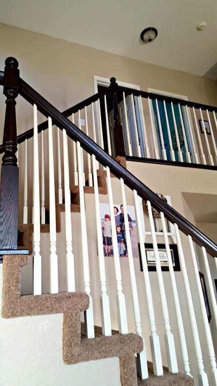 brown banister and white spindles