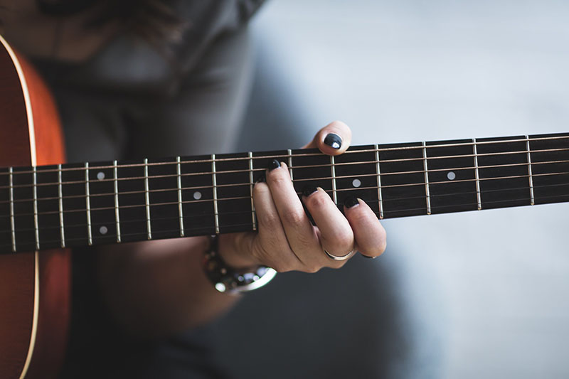 How to use Guitar Chord Progressions to Write Songs - Learn Guitar Malta