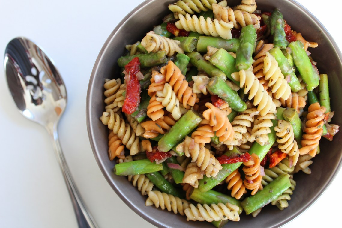 This fresh and bright pasta salad made with blanched asparagus, sun dried tomatoes, and a simple balsamic vinaigrette is perfect for an easy side dish or a simple lunch!