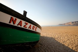 Nazare fishing boat on the sheltered side of the headland
