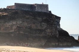 That's a big cliff - photo by Ben Poole, I'm walking over to paddle out.