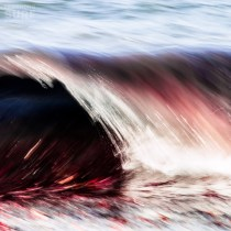 I brought out the red in the seaweed with Adobe Lightroom's hue controls, I like the zig zag pattern created by the lip and face of the wave moving in different directions. ISO 100, 200mm, f16, 1/10