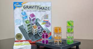 Gravity Maze board with three towers and the Gravity Maze box in the background