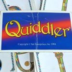 Pile of Quiddler cards on a table
