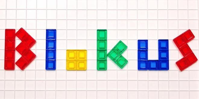 The word blokus spelled out in colored letters using Blokus game pieces on the Blokus game board