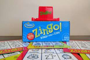 Zingo game with board tiles underneath