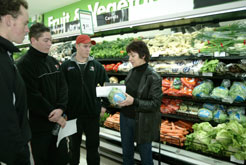 Lea on a supermarket tour with cricket academy students,